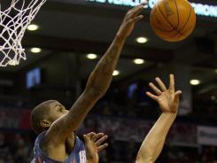 Bobcats forward Tyrus Thomas blocks a shot by Raptors guard Jerryd Bayless. Charlotte beat Toronto 98-91, breaking a 16-game losing streak.