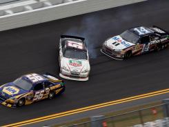 Kurt Busch, center, spins out in front of Tony Stewart, during practice for the Budweiser Shootout at Daytona International Speedway on Friday. Stewart is the defending Sprint Cup champion.