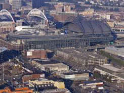 A panoramic view of Safeco Field and greater downtown Seattle. Christopher Hansen submitted a $290 million proposal for a new sports arena to the city that could bring NHL and NBA to the city.