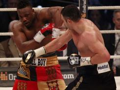 WBC heavyweight champion Vitali Klitschko, right, of Ukraine defeated challenger Dereck Chisora of Britain during their title fight at Olympic Hall in Munich.