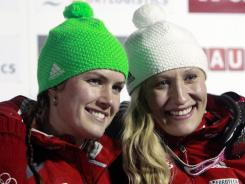 Canada's Kaillie Humphries, right, poses with teammate Jennifer Ciochetti after winning the women's bobsled world championships in Lake Placid, N.Y.