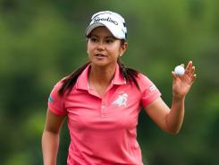 Ai Miyazato of Japan acknowledges the cheers after making a putt on the 18th green after Round 3 of the Honda LPGA Thailand.