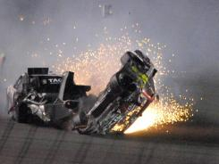 Jeff Gordon's car, after a final impact from Kurt Busch, slides on its roof after a spectacular lap 74 crash that saw the No. 24 Chevrolet flip several times. The four-time champion was uninjured during a Budweiser Shootout filled with crashes and won by Kyle Busch at the wire.