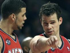 Nets forward Kris Humphries, right, talks with forward Jordan Williams during a break in the action during the first half against the Bulls in Chicago.