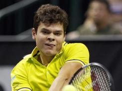 Milos Raonic (CAN) hits a backhand against opponent Ryan Harrison during their semifinal match of the SAP Open at HP Pavilion. Raonic will get to defend his title after defeating Harrison.