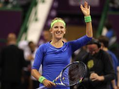 Victoria Azarenka waves to the crowd after beating Yanina Wickmayer in the quarterfinals in Doha, Qatar. Azarenka is riding a 15-match winning streak.