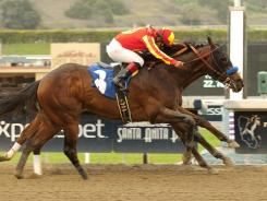 Drill and jockey Martin Garcia hold off American Act, with Martin Pedroza, to win the Grade II $150,000 San Vicente Stakes by a nose Sunday.