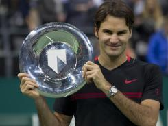 Roger Federer of Switzerland holds the trophy after defeating Juan Martin del Potro of Argentina 6-1, 6-4 in the final of the ABN AMRO tournament in Rotterdam, Netherlands.