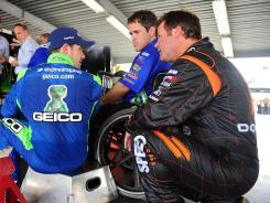 Owner/driver Robby Gordon, right, talks with fellow driver Casey Mears during practice for the Daytona 500.