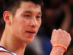Jeremy Lin wears a wristband from Active Faith.