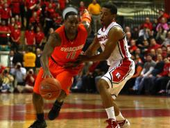 Scoop Jardine scored 17, including a dagger 3-pointer with 1:11 to play, as No. 2 Syracuse escaped another close one with a 74-64 victory over Rutgers on Sunday.