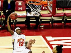Maryland Terrapins center Lynetta Kizer (12) grabs a rebound against the Blue Devils at the Comcast Center.