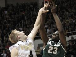 Draymond Green had 20 points and 10 rebounds to lead No. 8 Michigan State past short-handed Purdue 76-62 Sunday.