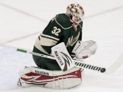 Minnesota Wild goalie Niklas Backstrom makes one of his 48 saves in a 3-0 shutout of the Boston Bruins on Sunday.
