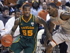 Baylor guard Pierre Jackson, left, drives around Texas guard Julien Lewis during the first half in Austin, Texas.