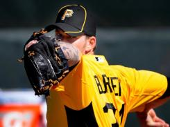 Newly acquired Pirates pitcher A.J. Burnett works out during camp at McKechnie Field.