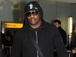 British boxer Dereck Chisora arrives at London's Heathrow Airport from Munich, Germany, on Sunday. Chisora was released Sunday after nearly seven hours of questioning from police following a post-fight brawl.