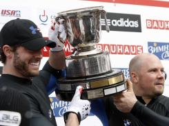 The USA's pilot Steven Holcomb, right, and brakeman Steven Langton react after winning the men's two-man bobsled world championships in Lake Placid, N.Y., on Sunday, Feb. 19, 2012.