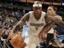 Al Harrington's 31 points helped the Nuggets pick up just their fourth win in 14 games.