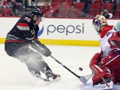 Carolina Hurricanes center Jiri Tlusty (19) is stopped on a break away by Washington Capitals goalie Michal Neuvirth (30) during the second period at the RBC center.