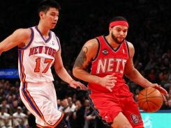 Deron Williams (8) poured in 38 points, including eight three-pointers, to lead the Nets by the Knicks and Jeremy Lin (17), who had 21 points.