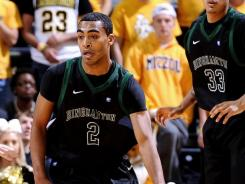 Binghamton guard Robert Mansell (2) and the Bearcats snapped a 27-game losing streak Tuesday night against Vermont.