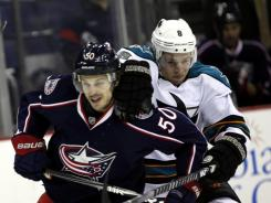 The Blue Jackets' Antoine Vermette, left, keeps the Sharks' Joe Pavelski away from the puck during the first period of their game on Tuesday game. Columbus doubled up San Jose's offensive output, winning 6-3.