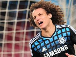 Chelsea defender David Luiz reacts after missing a goal opportunity against Napoli during the Champions League's first leg in the round of 16.