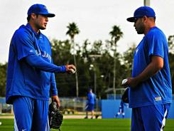 Blue Jays closer Sergio Santos, left, talking with starter Ricky Romero, was with the White Sox in 2011.