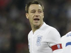 A file photo from Nov. 15, 2011, shows England's John Terry wearing the captain's armband ahead of an international friendly between England and Sweden at Wembley Stadium in London. The Associated Press reports that Terry has a knee injury that will keep him out of the Netherlands exhibition next week.