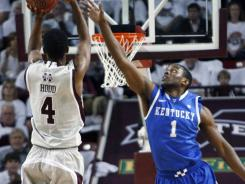 Kentucky guard Darius Miller (1) defends Mississippi State guard Rodney Hood in the second half in Starkville, Miss.