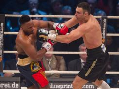 Vitali Klitschko, right, says he wants to fight British boxer Dereck Chisora again so he can knock him out.