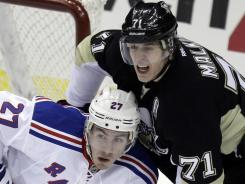 Rangers defenseman Ryan McDonagh battles for position with Penguins forward Evgeni Malkin. Malkin had a goal and an assist in Pittsburgh's win.