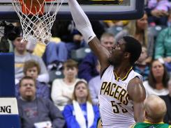 Pacers center Roy Hibbert (55) throws down two of his 30 points Tuesday against the Hornets at Bankers Life Fieldhouse.