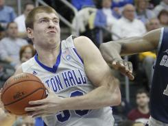 Seton Hall Pirates forward Patrik Auda, left, drives against Georgetown Hoyas forward Henry Sims during the first half at Prudential Center.