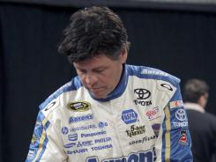 Driver/owner Michael Waltrip, autographing race helmets Feb. 16 at Daytona International Speedway, says he once blacked out at Las Vegas Motor Speedway and didn't tell anybody.