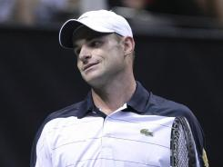 Andy Roddick, above, was upset by Xavier Malisse in the opening round of the Regions Morgan Keegan Championships on Wednesday.