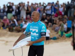 Kelly Slater, here at the 2011 Pipeline Masters at the Bonsai Pipeline North Shore of Oahu, Hawaii, won his first surfing title in 1992.