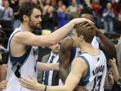Luke Ridnour (13) celebrates his game-winning shot that capped the Timberwolves' rally past the Jazz.