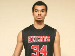 Wichita Heights player Perry Ellis had 30 points and 13 rebounds but his team lost Tuesday for the first time after 62 consecutive wins.