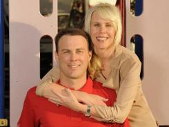 Kevin Harvick and his wife, DeLana, are shown at a playground at Daytona International Speedway. The couple is expecting their first child, a son, in July.