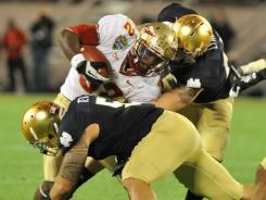 Florida State running back James Wilder Jr. carries against Notre Dame in the Champs Sports Bowl.