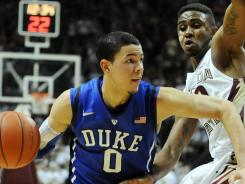 Duke guard Austin Rivers (0) drives past Florida State guard Ian Miller during the second half of the game at the Donald L. Tucker Center.
