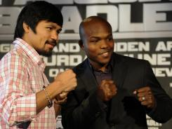 Manny Pacquiao and Timothy Bradley face off following a news conference in New York Thursday. They will fight for the WBO welterweight title on June 9.