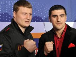 Russian WBA Heavyweight Champion Alexander Povetkin, left, and challenger Marco Huck pose during a press conference on Wednesday in Stuttgart, Germany.