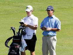 Will Claxton and his caddie wait in the fairway on the 18th hole Thursday during Round 1 of the Mayakoba Golf Classic at Riviera.