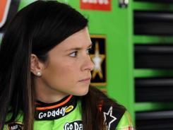 Danica Patrick, right, talks with Tony Stewart, left, after winning the pole for Saturday's NASCAR Drive4COPD 300.