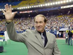 Gary Carter waves to fans during a pre-game ceremony by the Montreal Expos to retire the former catcher's number in 2003.