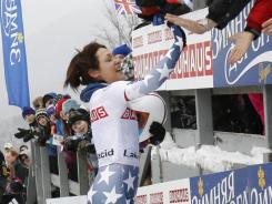 Colorado's Katie Uhlaender high-fives fans after winning the world skeleton title in Lake Placid on Friday.