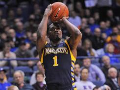 Marquette leading scorer Darius Johnson-Odom missed the first half of Friday's game at West Virginia along with four other players for violating team rules.